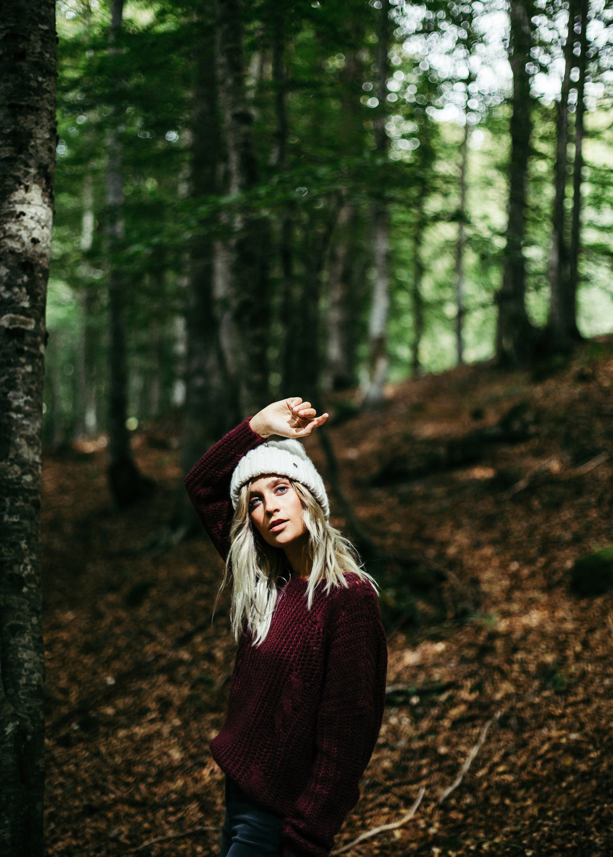 beautiful blond girl in the forest for editorial shoot