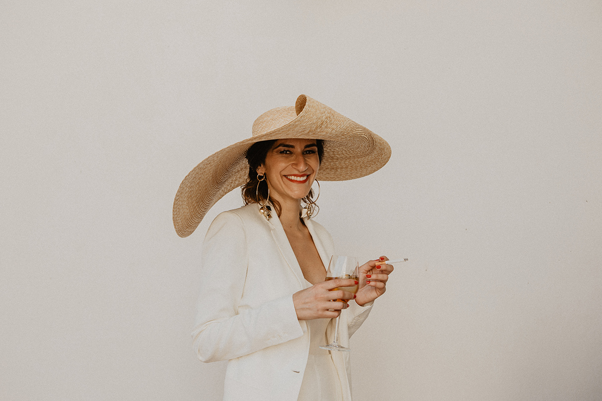 smiling modern bride with jaquemus hat